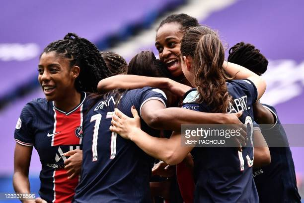 Paris' players celebrate after Lyons French defender Wendie Renard scored an own goal during the UEFA Womens Champions League quarter final football...
