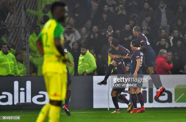 Paris' players celebrate after scoring during the French L1 football match between Nantes and Paris SaintGermain at the La Beaujoire stadium in...