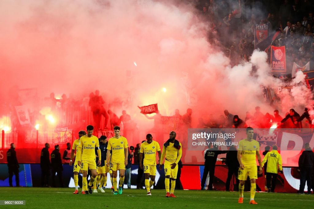 Paris' players leave the pitch after the French L1 football match between Caen (SMC) and Paris (PSG) on May 19, 2018, at the Michel d'Ornano stadium, in Caen, northwestern France.