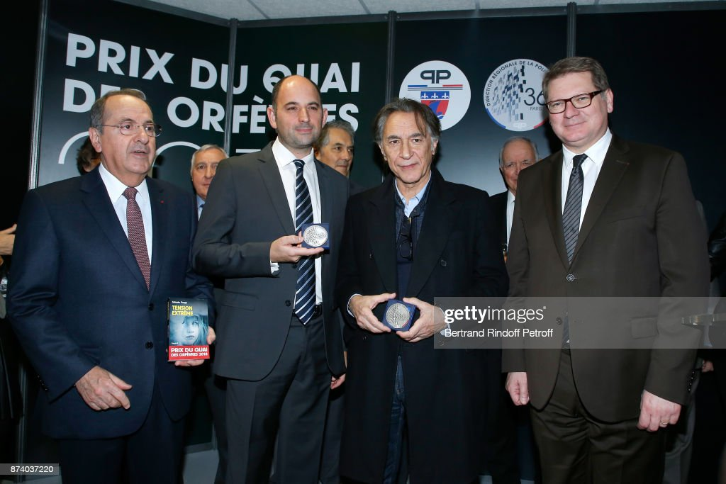 Paris Police Prefect Michel Delpuech, writer Sylvain Forge, Sponsor of the 2018 Prize, Richard Berry and Director of the 'Police Judiciaire' Christian Sainte attend Sylvain Forge wins the '71eme Prix du Quai des Orfevres - 2018' for his Book 'Tension Extreme'. Held for the first time at new local of the 'Direction Regionale de la Police Judiciaire', 36 Rue du Bastion in Paris, France on November 14, 2017.