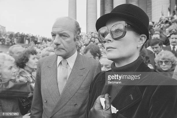 Princess Grace of Monaco escorted by Michel Guy French secretary of state for cultural affairs leaves church after attending funeral mass for...
