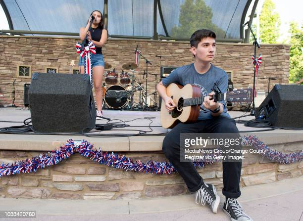 Paris Ramirez left and Jake Q, with the teen band Different Kinda Normal perform at the annual Music and Arts Festival at the Crown Valley...