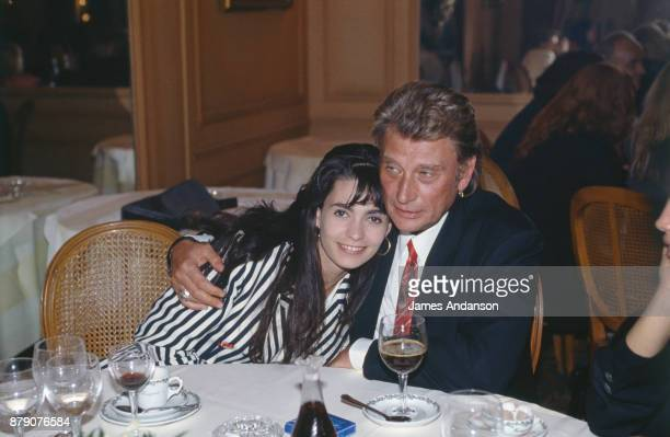 Paris Reunion of the french singer Johnny Hallyday and Adeline during a dinner at Fouquet's for the first of the movie 'La gamine' in which Johnny...