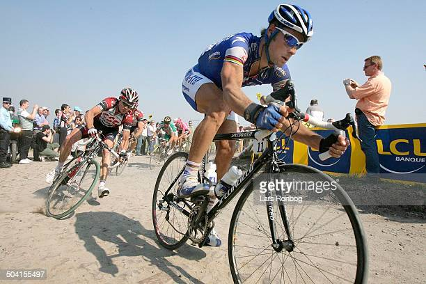 Paris - Roubaix - CRASH - Stuart O'Grady, Team CSC wins the race - rightTom Boonen, Quick Step.