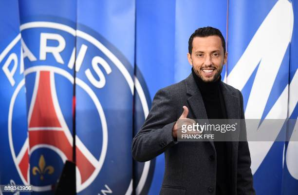 Paris Saint Germain's former player Brazilian midfielder Nene gives a thumbs up as he arrives to attend the French L1 football match between Paris...