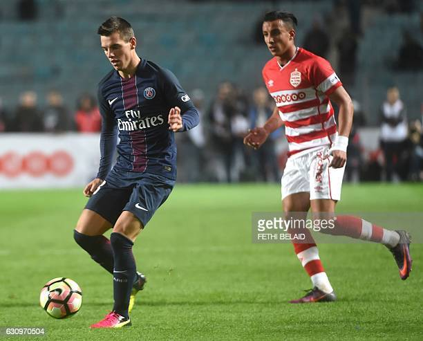 Paris Saint Germain's Giovani Lo Celso plays against Tunisia's Club Africain's Ahmed Khalil during the friendly football match between PSG and...