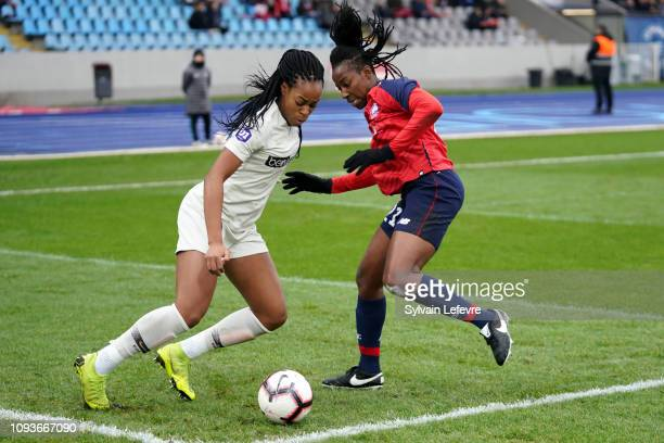 Paris Saint Germain's Marie Antoinette Katoto fights for the ball with Lille's Laetitia Chapeh Yimga during the Women's Division 1 match between...