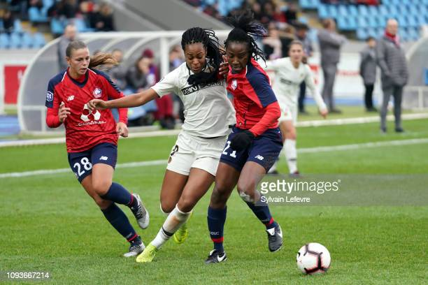 Paris Saint Germain's Marie Antoinette Katoto fights for the ball with Lille's Marine Dafeur and Laetitia Chapeh Yimga during the Women's Division 1...