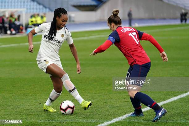Paris Saint Germain's Marie Antoinette Katoto fights for the ball with Lille's Maud Coutereels during the Women's Division 1 match between Lille and...