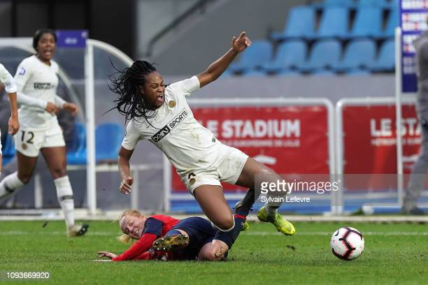 Paris Saint Germain's Marie Antoinette Katoto fights for the ball with Lille's Justine Bauduin during France women soccer 1st league match between...