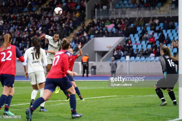 Paris Saint Germain's Marie Antoinette Katoto heads the ball during France women soccer 1st league match between Lille and PSG at Lille Metropole...