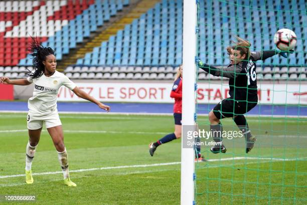 Paris Saint Germain's Marie Antoinette Katoto heads to score a goal during the Women's Division 1 match between Lille and PSG between Lille and PSG...