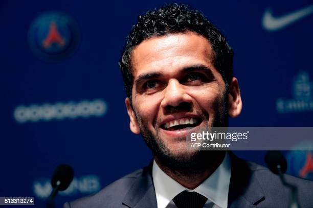 Paris Saint Germain's new Brazilian defender Dani Alves gives a press conference on July 12 in Paris Alves has signed a twoyear deal with Paris...