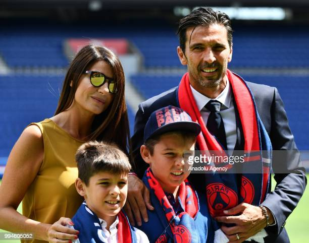 Paris Saint Germain's new goalkeeper Gianluigi Buffon poses after his official presentation press conference with his wife Alena Seredova , his sons...