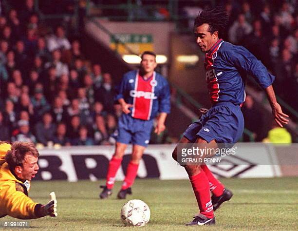 Paris Saint Germain's star striker Patrice Loko puts the ball past Glasgow Celtic keeper Gordon Marshall to put PSG 10 up during their second leg Cup...