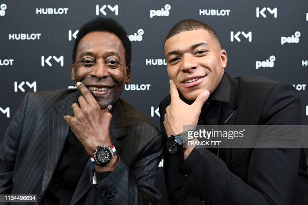 Paris SaintGermain and France national football team forward Kylian Mbappe and Brazilian football legend Pele pose during their meeting at the Hotel...