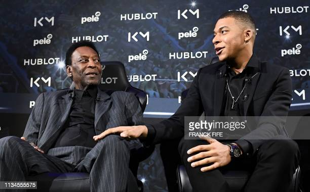 Paris SaintGermain and France national football team forward Kylian Mbappe and Brazilian football legend Pele take part in a meeting at the Hotel...