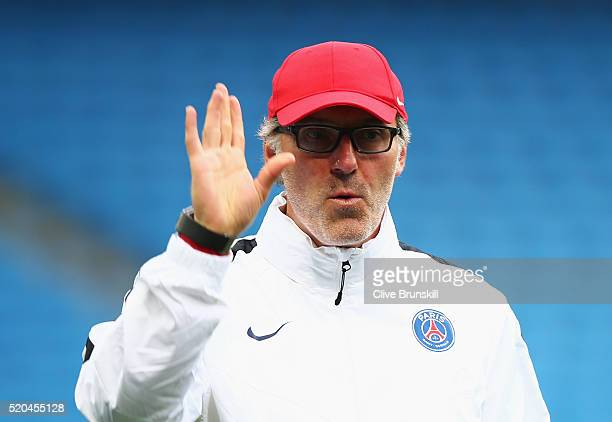 Paris SaintGermain coach Laurent Blanc gestures during a training session ahead of the UEFA Champions League Quarter Final Second Leg match against...