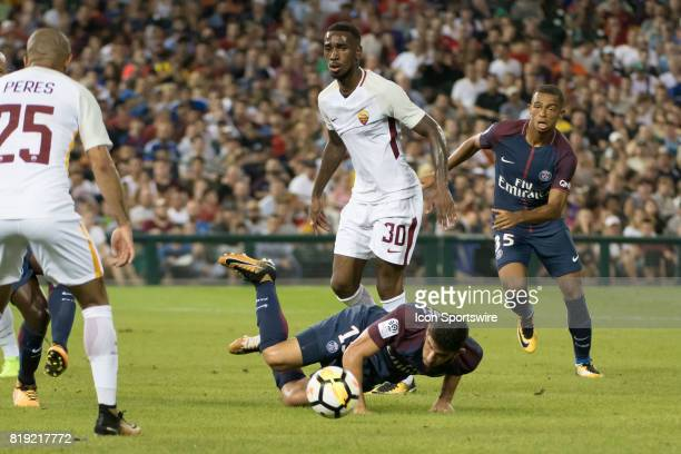 Paris SaintGermain F Gonçalo Guedes tumbles trying to get by AS Roma M Gerson during the International Champions Cup match between AS Roma and Paris...