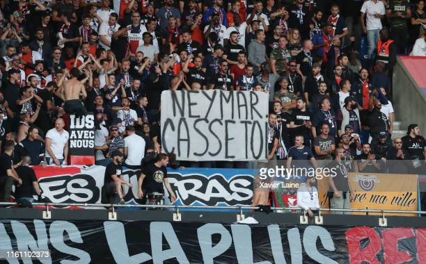 Paris SaintGermain fans display a banner Neymar go away during the Ligue 1 match between Paris SaintGermain and Nimes Olympique at Parc des Princes...