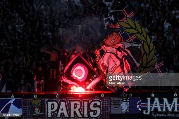 Paris Saint-Germain fans let off flares during the UEFA Champions League group A match between Paris Saint-Germain and Manchester City at Parc des...