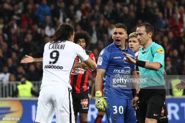 Paris SaintGermain forward Edinson Cavani talks with the referee during the Ligue 1 football match n35 OGC NICE PARIS SG on at the Allianz Riviera in...