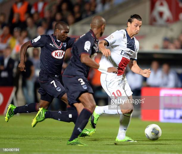 Paris SaintGermain forward Zlatan Ibrahimovic vies with Bordeaux Brazilain Enrique during the French L1 football match between FC Girondins de...