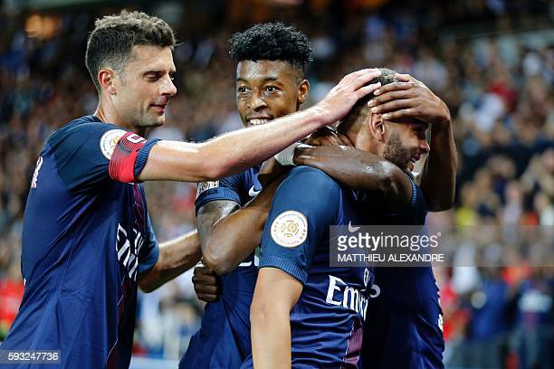 Paris SaintGermain' French defender Layvin Kurzawa celebrates his teammates after scoring during the French Ligue 1 Football match between Paris...
