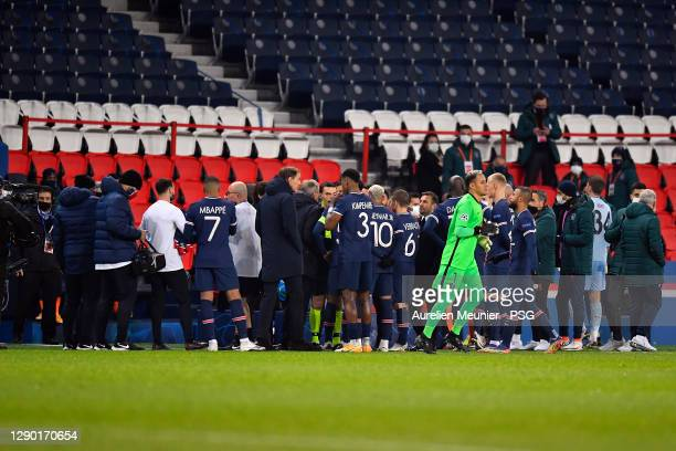 Paris Saint-Germain head coach speaks to his players during the confusion following an alleged incident between Istanbul Basaksehir assistant manager...