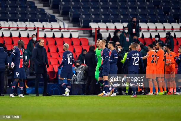 Paris Saint-Germain head coach speaks to Neymar Jr during the confusion following an alleged incident between Istanbul Basaksehir assistant manager...