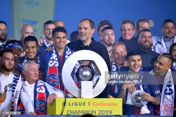 Paris Saint-Germain head coach Thomas Tuchel and Paris Saint-Germain Captain Thiago Silva react as they receive the French Ligue 1 championship...