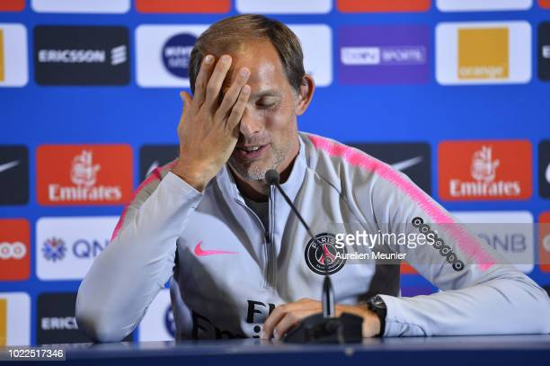 Paris SaintGermain head coach Thomas Tuchel answers journalists during a press conference at Ooredoo Center on August 24 2018 in Paris France