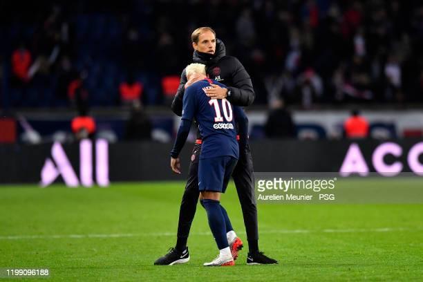 Paris Saint-Germain head coach Thomas Tuchel conforts Neymar Jr reacts after the Ligue 1 match between Paris Saint-Germain and AS Monaco at Parc des...