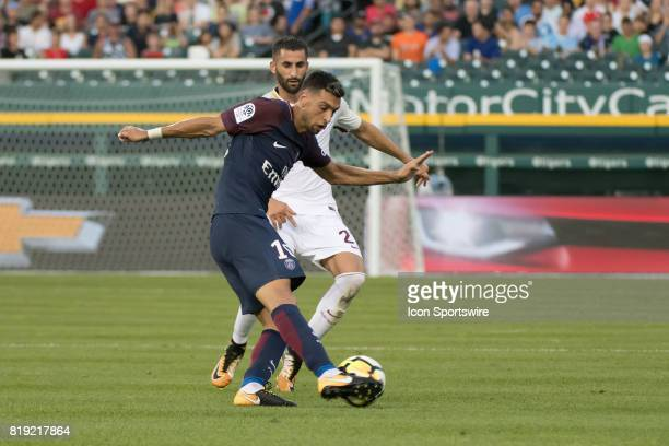 Paris SaintGermain M Javier Pastore tries to get around AS Roma D Leandro Castán during the International Champions Cup match between AS Roma and...