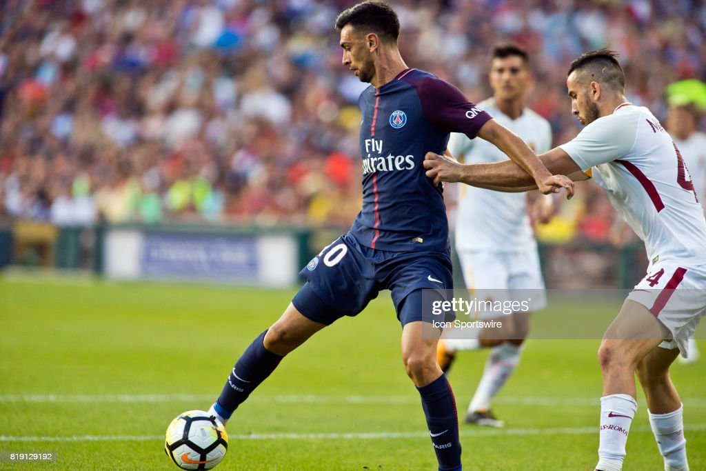 Paris Saint-Germain midfielder Javier Pastore (10) reaches for the ball, defended by AS Roma defender Konstantinos Manolas (44) during an International Champions Cup match between AS Roma and Paris Saint-Germain on July 19, 2017 at Comerica Park in Detroit, Michigan. PSG won 2-1 on penalty kicks.