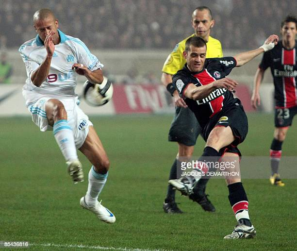 Paris SaintGermain midfielder Jerome Rothen kicks the ball in front of Marseille's defender Tyrone Mears of UK during the French L1 football match...