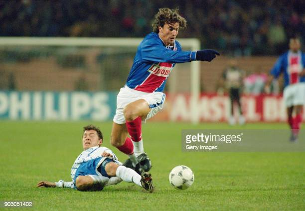 Paris SaintGermain player David Ginola is tackled during a UEFA Champions League group stage match against Dynamo Kiev on October 19 1995 in Kiev...