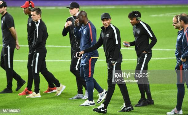 Paris SaintGermain player Kylian Mbappe and teammates attend a training session at the Constant Vanden Stock Stadium in Brussels on October 17 2017...