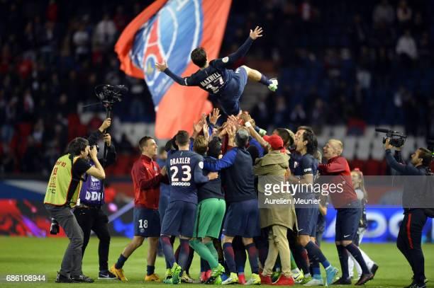 Paris SaintGermain players celebrate Maxwell last game before his retires after the Ligue 1 match between Paris SaintGermain and SM Caen at Parc des...