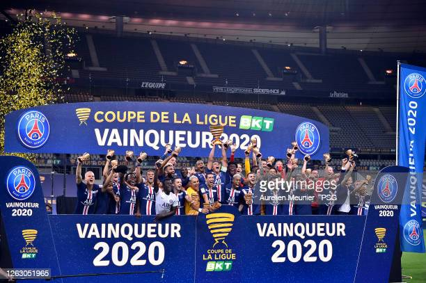 Paris SaintGermain players raise the Trophy after winning the French League Cup final match against Olympique Lyonnais after the penalty kick session...