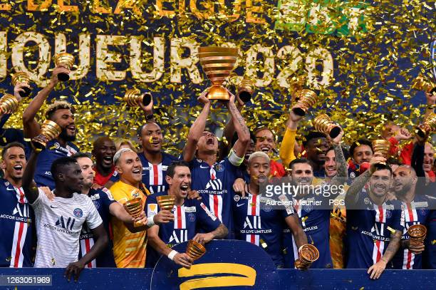 Paris Saint-Germain players raise the Trophy after winning the French League Cup final match against Olympique Lyonnais after the penalty kick...