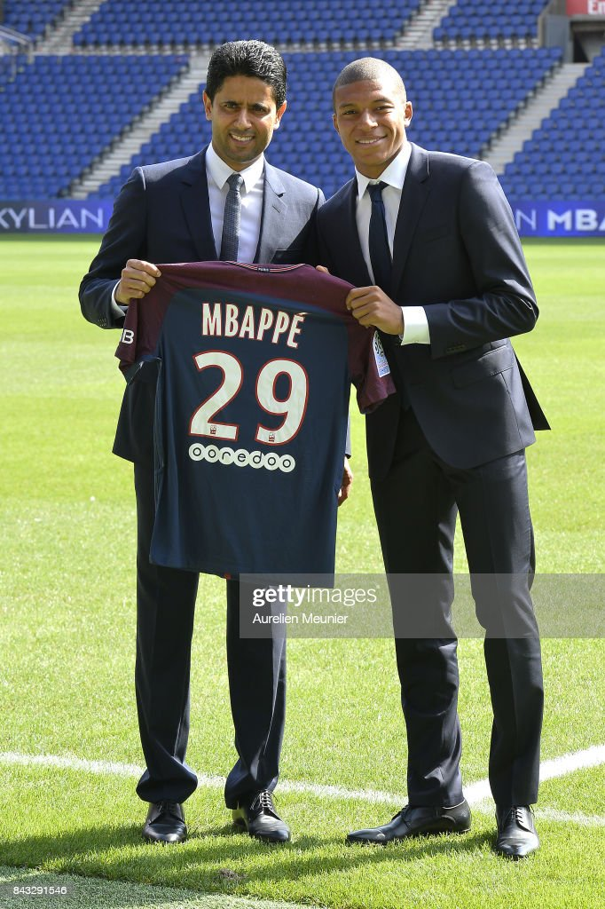 Paris Saint-Germain President Nasser Al Khelaifi poses alongside new signing Kylian Mbappe at the Parc des Princes on September 6, 2017 in Paris, France. Kylian Mbappe signed a five year contract for 180 Million Euro.