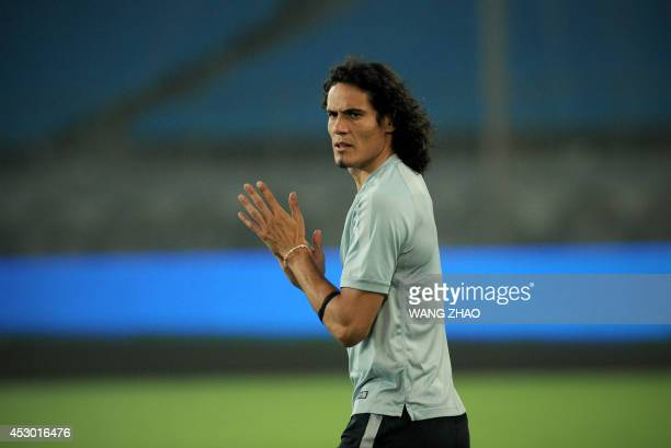 Paris Saint-Germain striker Edinson Cavani takes part in a training session at the Beijing Workers Stadium on August 1 a day before the team's...