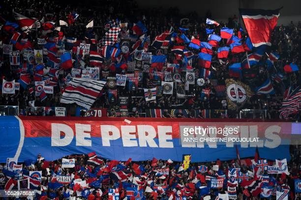 Paris Saint-Germain supporters cheer for their team during the UEFA Champions League Group C football match between Paris Saint-Germain and SSC...
