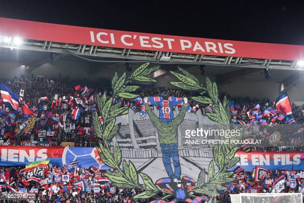 Paris SaintGermain supporters cheer for their team during the UEFA Champions League Group C football match between Paris SaintGermain and SSC Napoli...
