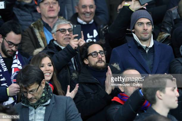Paris SaintGermain supporters son of François Hollande celebrate victory after the UEFA Champions League Round of 16 first leg match between Paris...