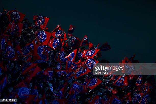 Paris SaintGermain supporters wave flags prior to the UEFA Champions League Quarter Final First Leg match between Paris SaintGermain and Manchester...