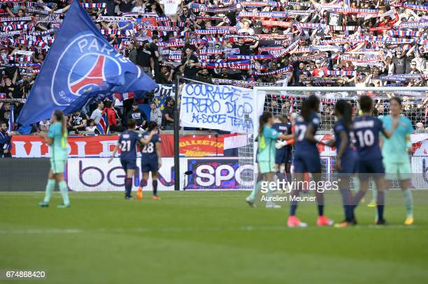 Paris SaintGermain supporters waving flags and scarves during the Women's Champions League match between Paris Saint Germain and Barcelona at Parc...