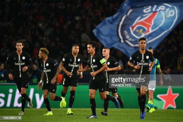 Paris SaintGermain team players celebrate after Napoli's Portuguese defender Mario Rui scored and own goal during the UEFA Champions League Group C...