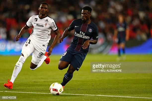 Paris SaintGermain Uruguayan forward Edinson Cavani vies for the ball with Metz forward Opa Nguette during the French Ligue 1 Football match between...